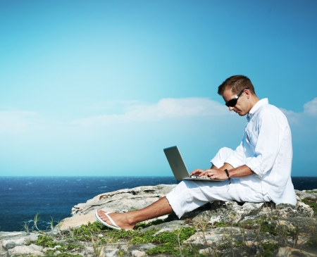 guy with laptop: Young Man with Laptop Outdoor