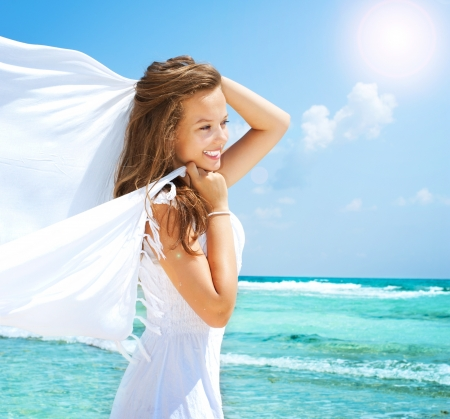 Girl With White Scarf on The Beach  Travel and Vacation photo
