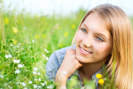 Beautiful Girl Relaxing outdoors  Happy and Smiling Stock Photo - 13931979