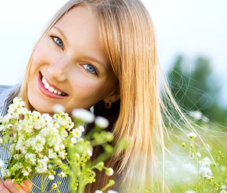 Beautiful Girl lying on Meadow of Flowers and Green Grass Stock Photo - 13955222