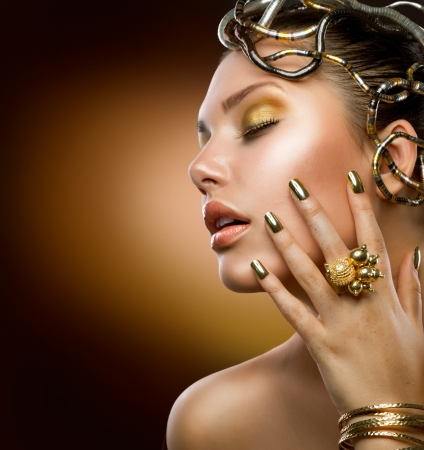 nails manicure: Golden Makeup  Fashion Girl Portrait  Stock Photo