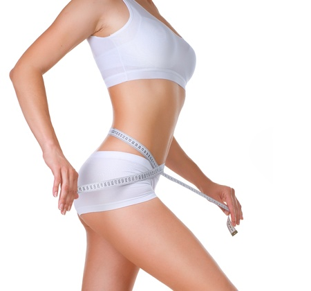 slim woman: Woman measuring her waistline  Diet  Perfect Slim Body  Stock Photo