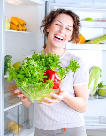 Beautiful Young Woman near the Refrigerator with healthy food Stock Photo - 14054140