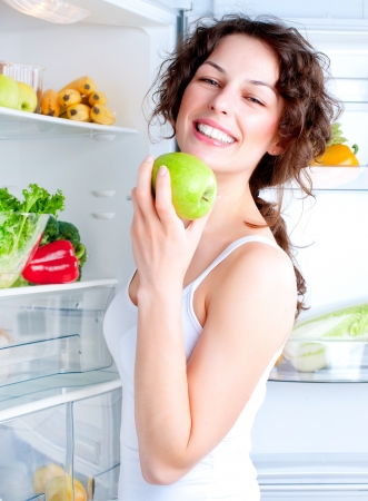 Beautiful Young Woman near the Refrigerator with healthy food Stock Photo - 14054141