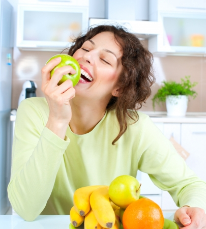 Dieting concept  Healthy Food  Young Woman Eats Fresh Fruit Stock Photo - 14054136