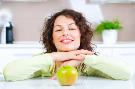 Dieting concept  Healthy Food  Young Woman Eats Fresh Fruit photo