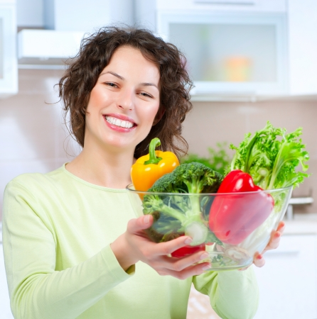 Beautiful Young Woman with healthy food  Stock Photo - 14054129