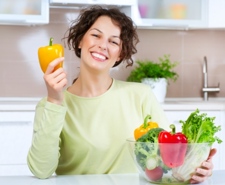 Beautiful Young Woman with healthy food  Stock Photo - 14054138
