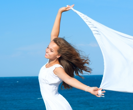 scarf beach: Girl With White Scarf on The Beach  Travel and Vacation Stock Photo