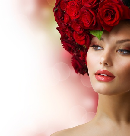 Fashion Model Portrait with Red Roses Hair  photo