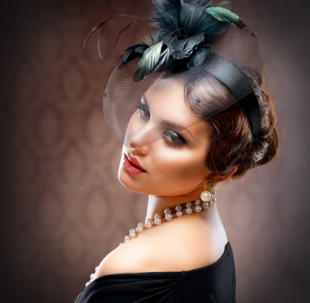 Retro Beauty Portrait  Vintage Styled  Beautiful Young Woman  photo
