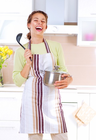ladles: Young woman cooking healthy food