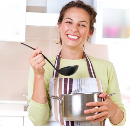 boiling: Young woman cooking healthy food