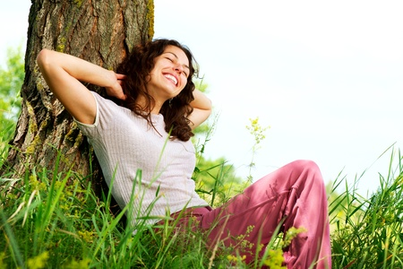 glade: Beautiful Young Woman Relaxing outdoors  Nature Stock Photo