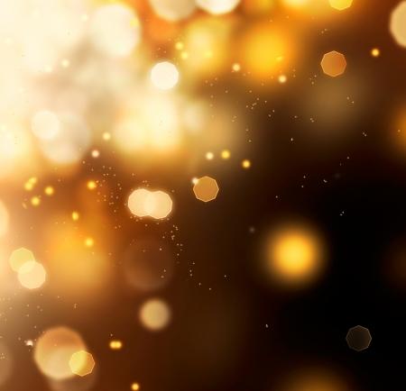 黒の上の黄金の抽象的な背景のボケ味金塵
