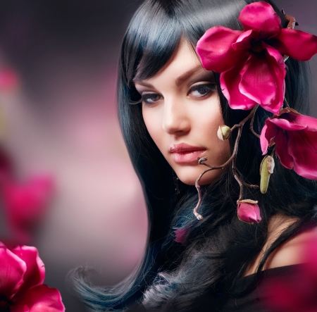 fashion make up: Fashion Brunette Girl with Magnolia Flower  Stock Photo