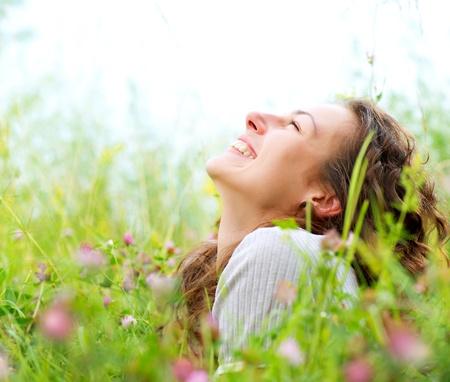 woman lying down: Beautiful Young Woman Outdoors  Enjoy Nature  Meadow Stock Photo
