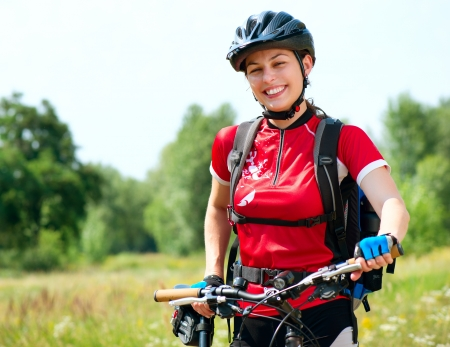 Happy Young Woman riding bicycle outside  Healthy Lifestyle photo