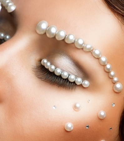 wedding hairstyle: Creative Makeup With Pearls  Beautiful Young Woman Portrait