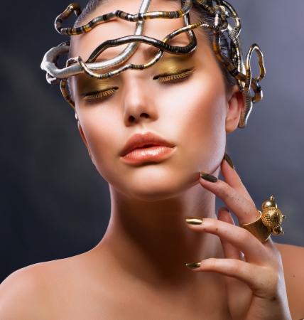coloring lips: Fashion Girl Portrait  Gold Makeup Stock Photo