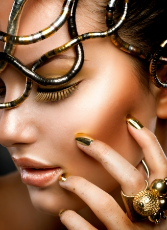 gold jewelry: Fashion Girl Portrait  Gold Makeup  Stock Photo