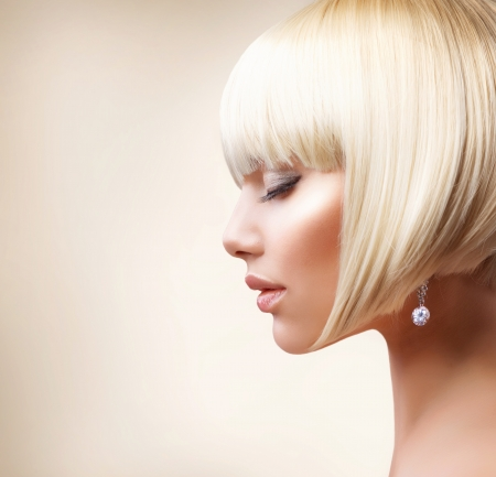 short: Blond Hair  Beautiful Girl with Healthy Short Hair  Stock Photo