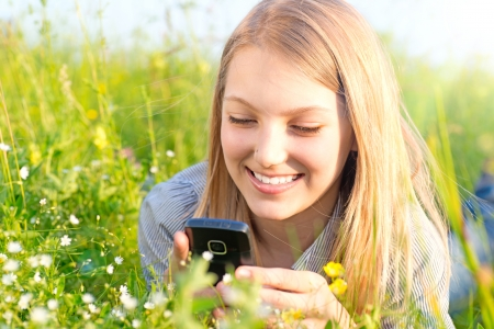 call of nature: Beautiful Teenage Girl With Cellphone outdoors