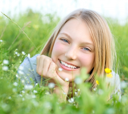Smiling Girl Relaxing outdoors  Meadow