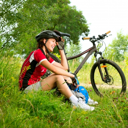 mountain bike: Happy Young Woman riding bicycle outside  Healthy Lifestyle