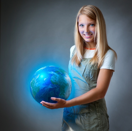 Girl holding the Planet Earth  Environment Concept photo