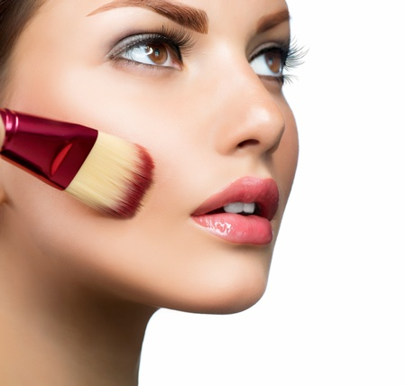 woman face close up: Cosmetic  Base for Perfect Make-up  Applying Make-up
