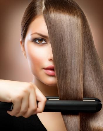 Hairstyling Hairdressing Hair Straightening Irons Straight Hair  Stock Photo