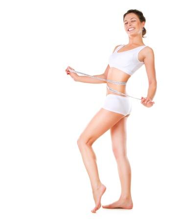 허리의 잘룩 한 선: 여자가 그녀의 허리 완벽한 슬림 바디를 측정 스톡 사진