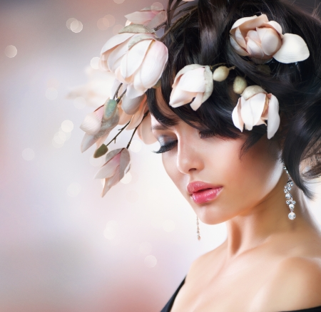 Fashion Brunette Girl with Magnolia  Hairstyle photo