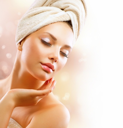Spa Girl  Beautiful Young Woman After Bath Touching Her Face Stock Photo - 14646692