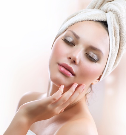 skincare facial: Spa Girl  Beautiful Young Woman After Bath Touching Her Face
