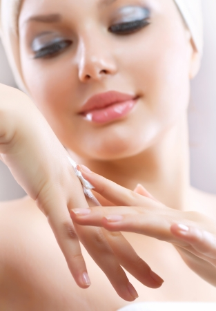 Hands Cream  Female applying moisturizer to her Hand after bath  Stock Photo - 14646663