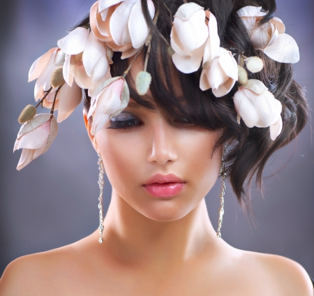 Fashion Brunette Girl with Magnolia Flowers  Hairstyle  photo