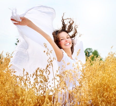 Beautiful Happy Girl on the Wheat Field photo