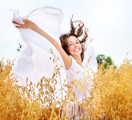 oats: Beautiful Happy Girl on the Wheat Field