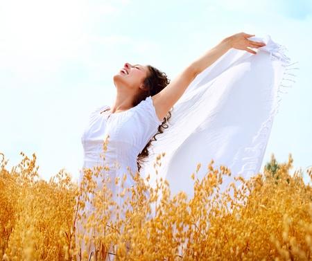 Beautiful Happy Girl Having Fun on the Wheat Field Stock Photo - 14719027