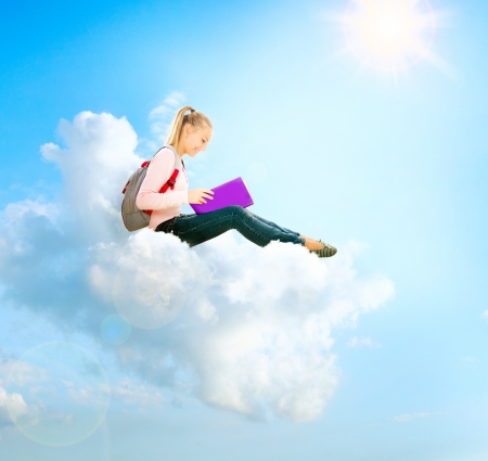 School Girl or Student Sitting on a Cloud and Reading a book Stock Photo - 14792089