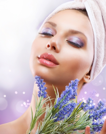 hand towel: Spa Girl with Lavender Flowers  Organic Cosmetics Stock Photo