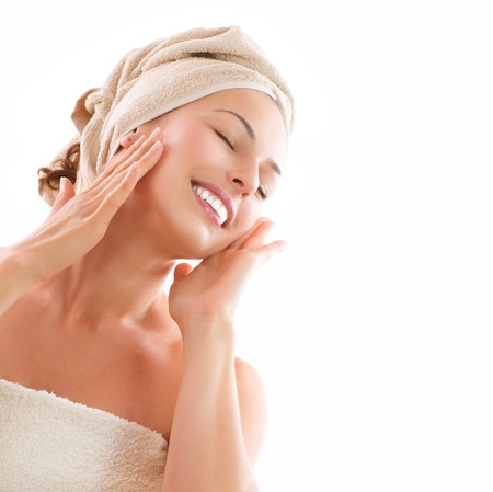 face cream: Beautiful Girl After Bath Touching Her Face  Skincare Stock Photo