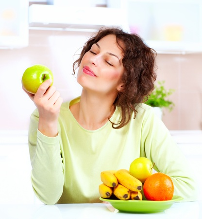 Dieting concept  Healthy Food  Young Woman Eats Fresh Fruit Stock Photo - 15044015