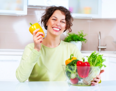 Beautiful Young Woman with healthy food Stock Photo - 15044018