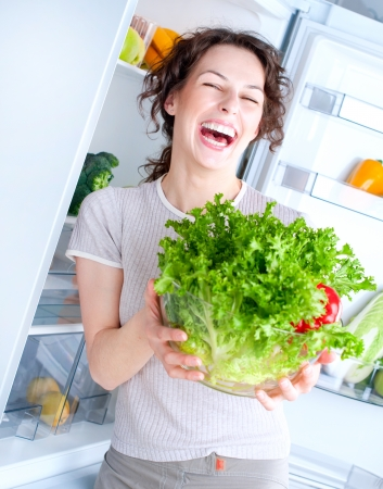 Beautiful Young Woman near the Refrigerator with healthy food Stock Photo - 15044030