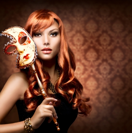 retro woman: Beautiful Woman with the Carnival mask  Stock Photo