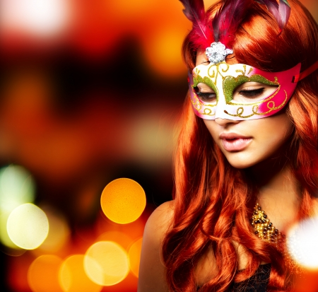 Masquerade  Beautiful Girl in a Carnival mask  photo