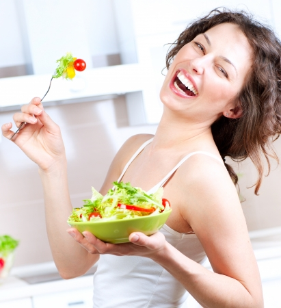 thin: Diet  Healthy Young Woman Eating Vegetable Salad